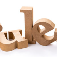 "wooden letters spelling ""rules"" toppled over haphazardly"