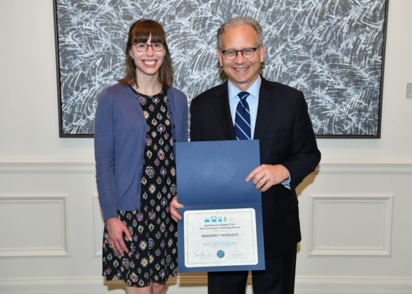 Pictured: Ashley Majewski (Coordinator, Division of Administration Programs) with Mayor Briley)