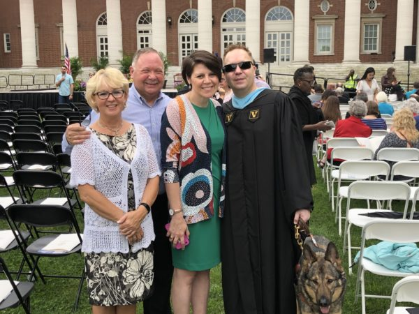 James Boehm (far right) with his parents and wife on Commencement day 2019.