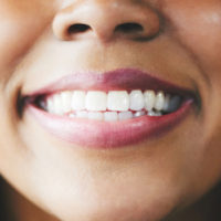 Close up of smiling African-American woman's mouth