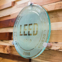 The U.S. Green Building Council presented Vanderbilt with a plaque designating the university's Engineering and Science Building and Eskind Biomedical Library with LEED Gold status. (Susan Urmy/Vanderbilt)