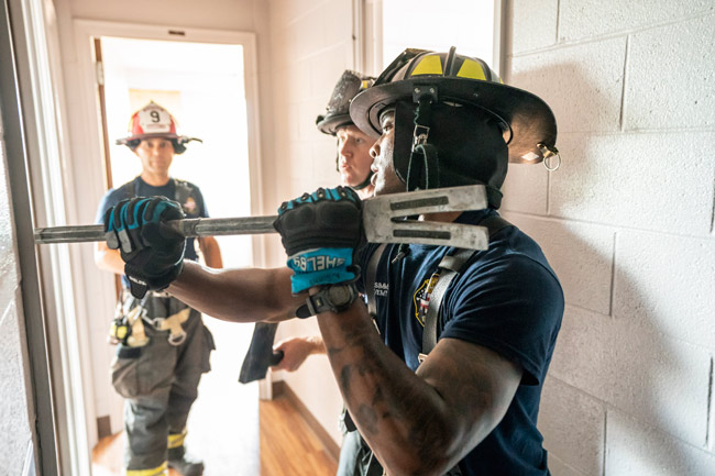 Nashville firefighters deployed hoses, operated ladders, forced open doors and practiced search-and-rescue tactics when they took part in a unique training opportunity at Vanderbilt University's 14-story Carmichael Tower 4 residence hall June 18-29. (John Russell/Vanderbilt)