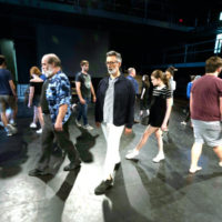 Mark Cabus (center) with other cast members of 'The Tempest' rehearsing at Neely Auditorium (Joe Howell)