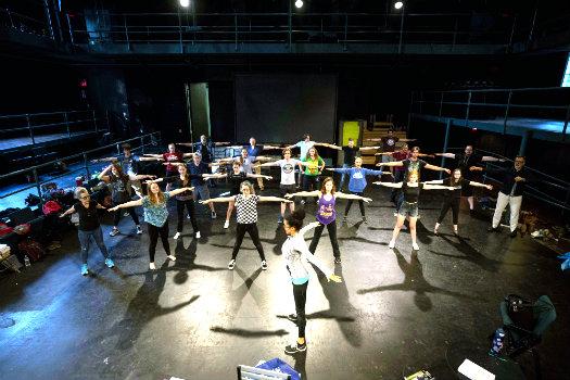 Choreographer Tosha Pendergrast leads 'The Tempest' cast in warm-up movement at Neely Auditorium (Joe Howell/Vanderbilt University)