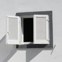 white building with open window shutters on the Island of Panarea, Sicily