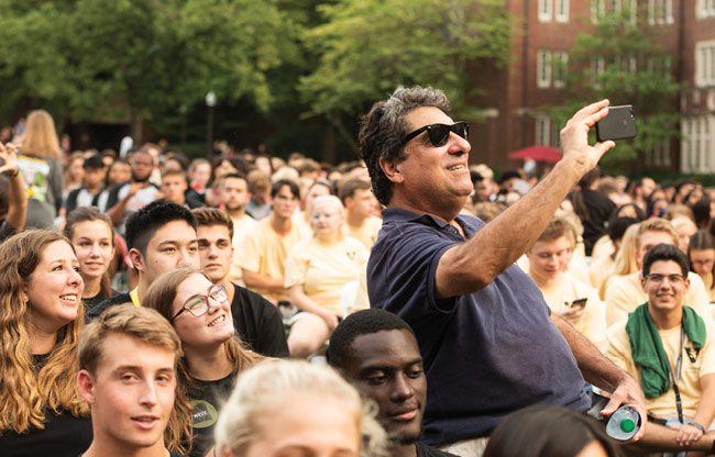 Chancellor Nicholas S. Zeppos poses for selfies with students at Founders Walk. (Vanderbilt University)