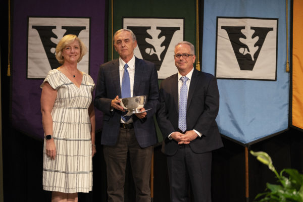 W. Kip Viscusi (center), University Distinguished Professor of Law, Economics and Management, was awarded the Earl Sutherland Prize for Achievement in Research by Interim Chancellor and Provost Susan R. Wente (left) and Faculty Senate Chair John McLean (right) during the 2019 Fall Faculty Assembly. (Joe Howell/Vanderbilt)