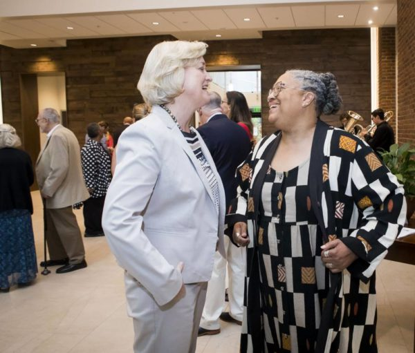 Interim Chancellor and Provost Susan R. Wente (left) and Divinity School Dean Emilie M. Townes at the ribbon-cutting ceremony for the Divinity School's recent renovation and expansion. (Susan Urmy/Vanderbilt)