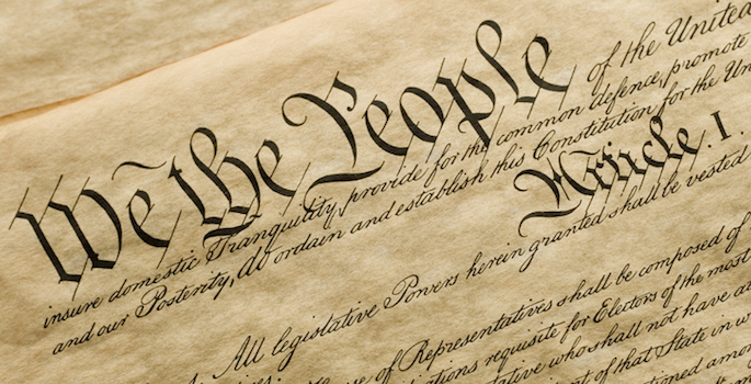 "Close up photo of ""We the People"" portion of the U.S. Constitution"