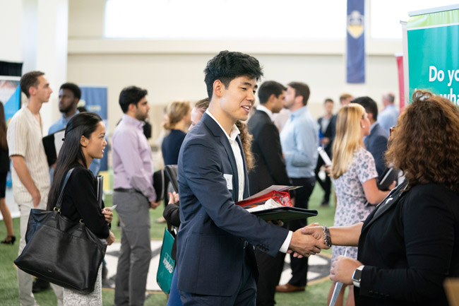 Top companies such as AllianceBernstein, Amazon, ExxonMobil, Defense Intelligence Agency, Lilly USA, Microsoft Corporation, Teach for America and Vineyard Vines were represented at the fall Career Fair on Sept. 11. (Joe Howell/Vanderbilt)