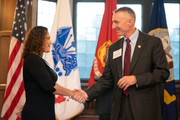 Lt. Gen. Gary Cheek (right) presents the specially designed Bass Military Scholar challenge coin to U.S. Army veteran and School of Nursing student Vanessa Thomsen-Johnson. (Joe Howell/Vanderbilt)