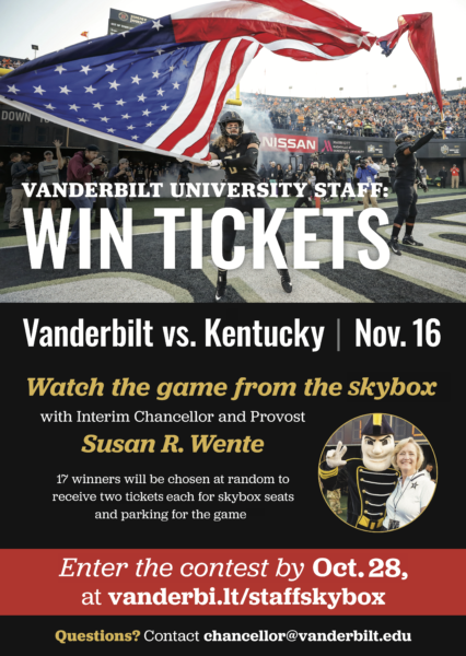A Vanderbilt football player waves an American flag and Interim Chancellor and Provost Susan R. Wente with Mr. C.