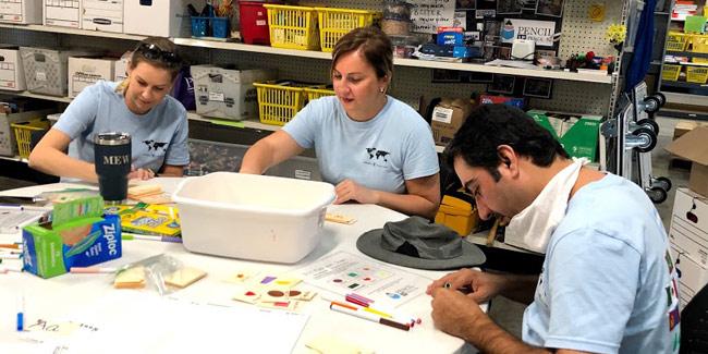 During their time at LP Pencil Box, the Humphrey Fellows bundled supplies and stocked the program's storeroom. (Vanderbilt University)