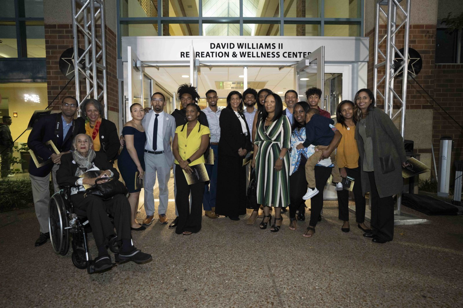 Friends and family of David Williams stand in front of the new signage at the David Williams II Recreation and Wellness Center. (John Russell/Vanderbilt University)