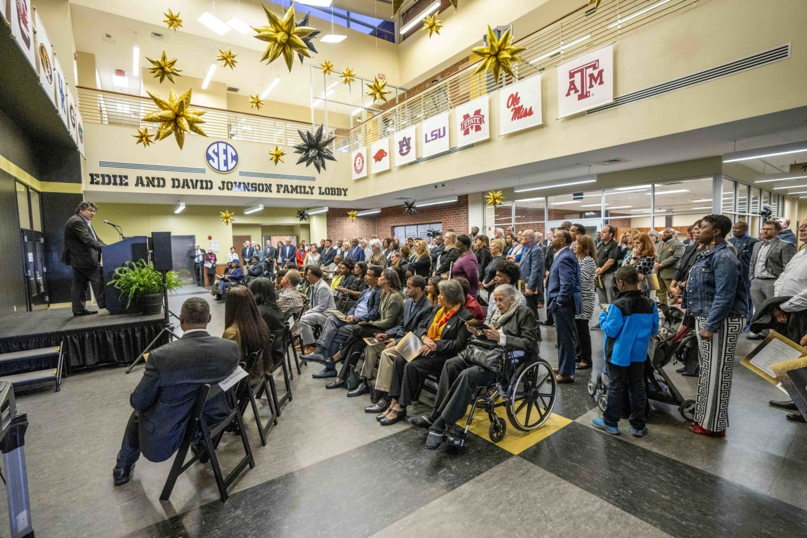 Friends and family of David Williams gather in the SEC Johnson Lobby of the David Williams II Recreation and Wellness Center. (John Russell/Vanderbilt University)