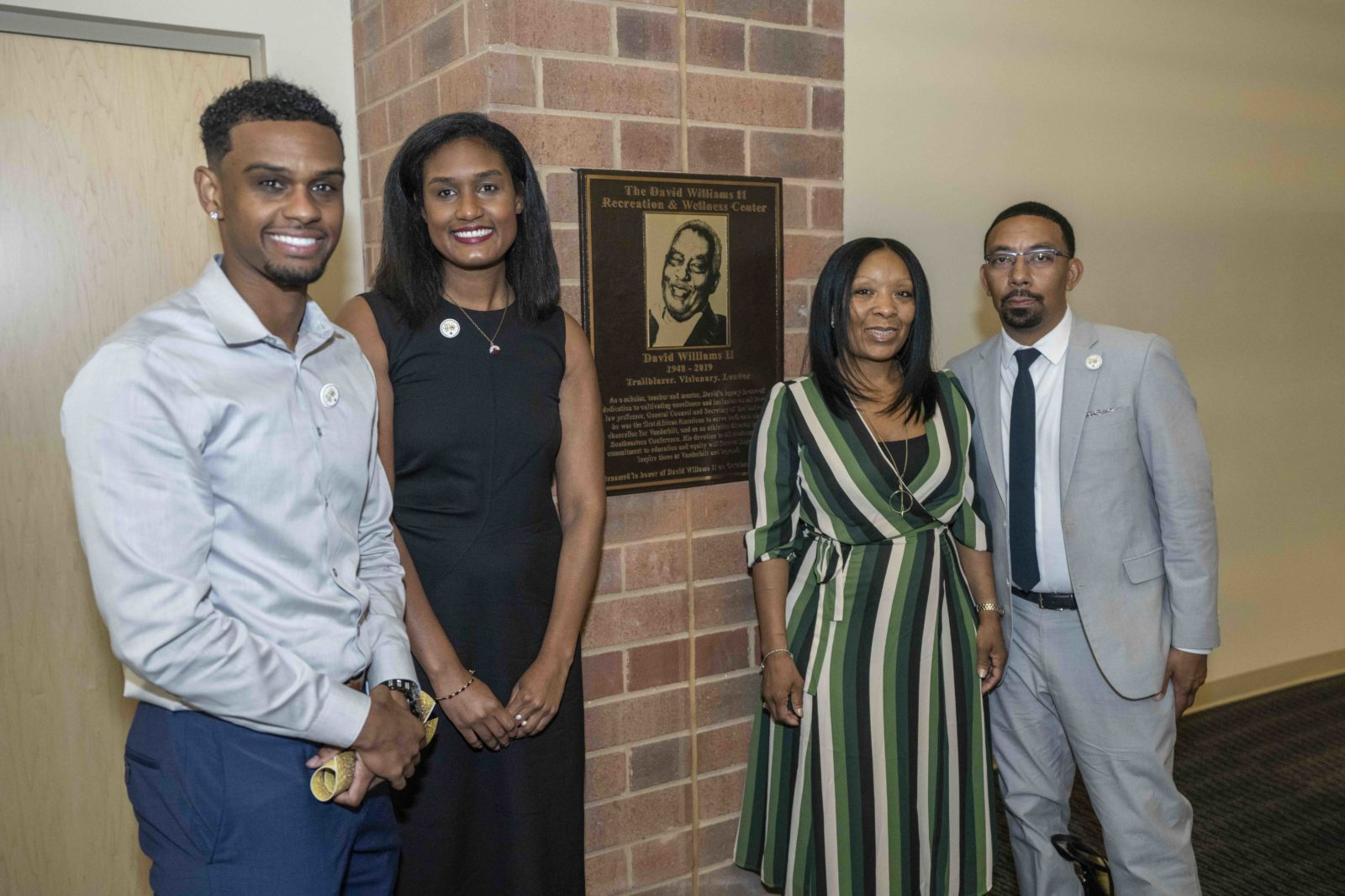 David Williams' children stand next to a new plaque honoring Vanderbilt's late former athletics director and vice chancellor. (John Russell/Vanderbilt University)