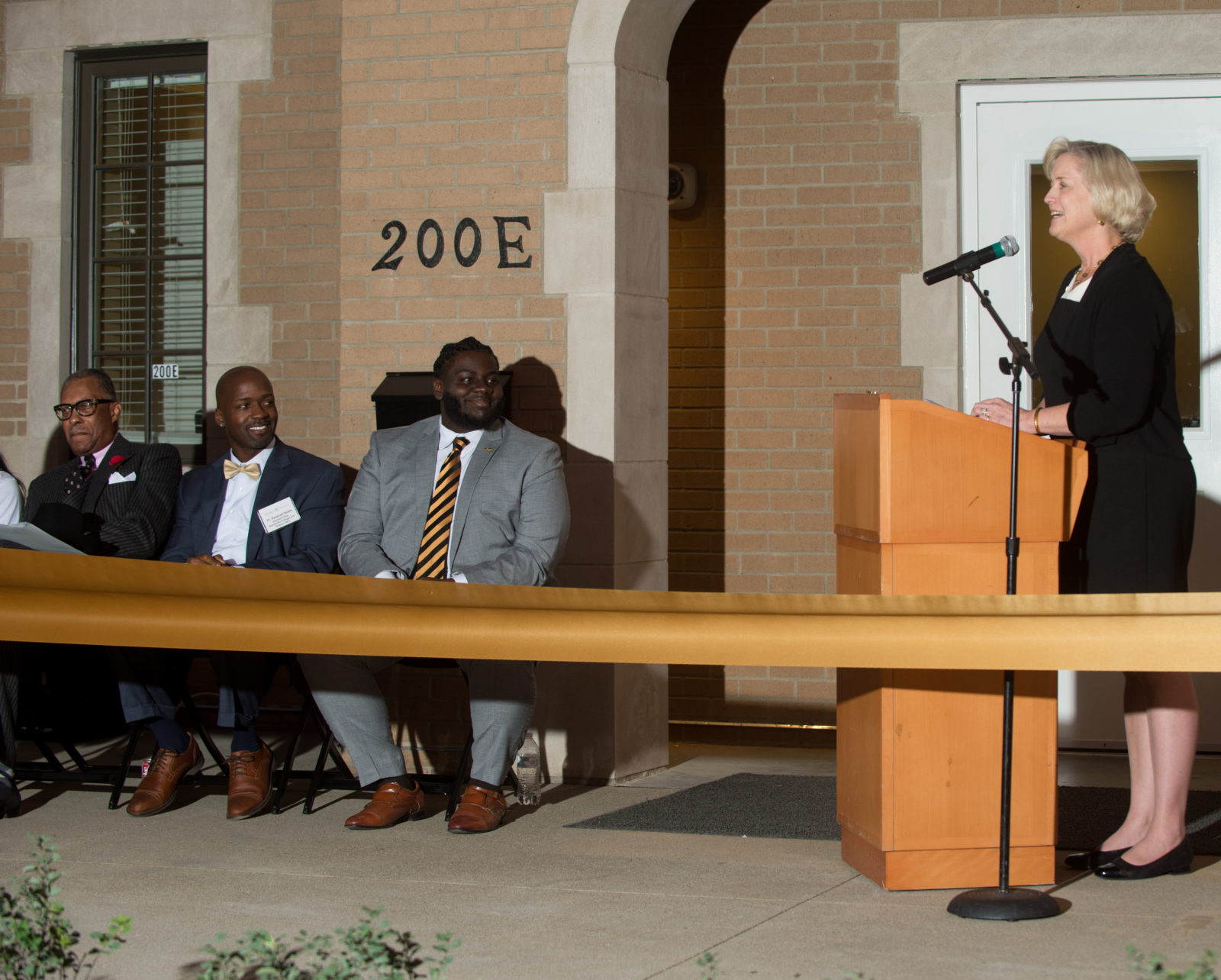 Interim Chancellor and Provost Susan R. Wente giving remarks at the new Pan-Hellenic Council House house ribbon-cutting at Vanderbilt University on Oct. 18, 2019. (Price Chambers for Vanderbilt University)
