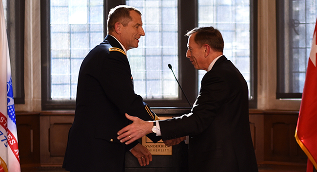 "Former CIA Director and retired Army Gen. David Petraeus (right) congratulates Vanderbilt alumnus Maj. Gen. William ""Bill"" Hickman, BS'83, MBA'92, on his upcoming retirement from the U.S. Army. (Adrienne Burns/Vanderbilt)"
