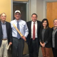 Vice Chancellor Lutz poses with a Roman glades sword replica