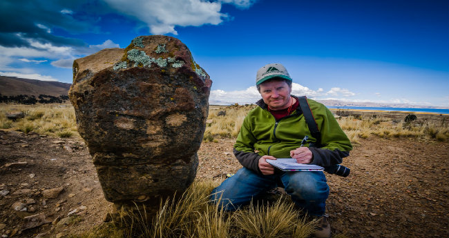 Associate Professor of Anthropology John Janusek researching Andean monoliths (courtesy of Andy Roddick)