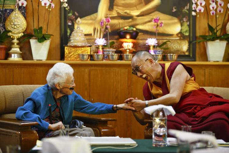 Sallie McFague meeting the Dalia Lama during a 2011 conference on ecology, ethics and interdependence.