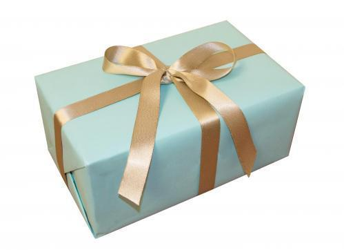 a box neatly wrapped in light blue paper with a gold bow