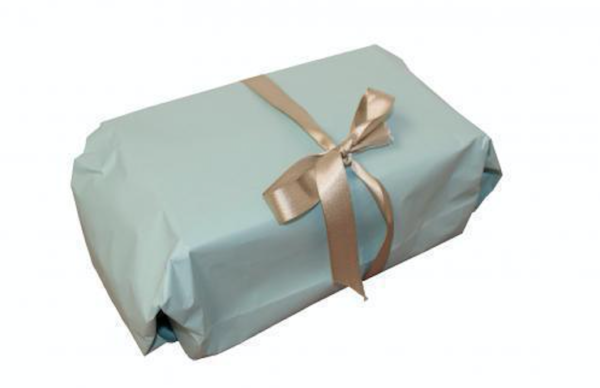 a box sloppily wrapped in light blue paper with a badly tied gold bow