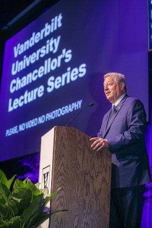 Former Vice President Al Gore at podium during climate crisis presentation at Langford Auditorium (photo by Anne Rayner at Vanderbilt University)