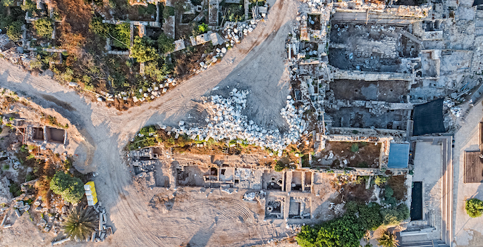 aerial view of excavated square dwellings including walls and debris of floors
