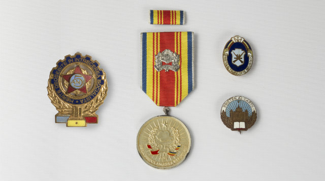 Commemorative pins awarded to supporters of the Ceaușescu regime (courtesy of the Michelson Collection)