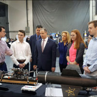VADL team members talk with James Bridenstine, NASA Marshall Director Jody Singer and Mike Kincaid, associate administrator, Office of NASA STEM Engagement, at NASA's Artemis Day in New Orleans. Front, left to right, Jon Powles, Alex Barnett, Bridenstine, Abbey Carlson, Sophia Moak and Adam Smith. Rear, Kincaid and Singer.