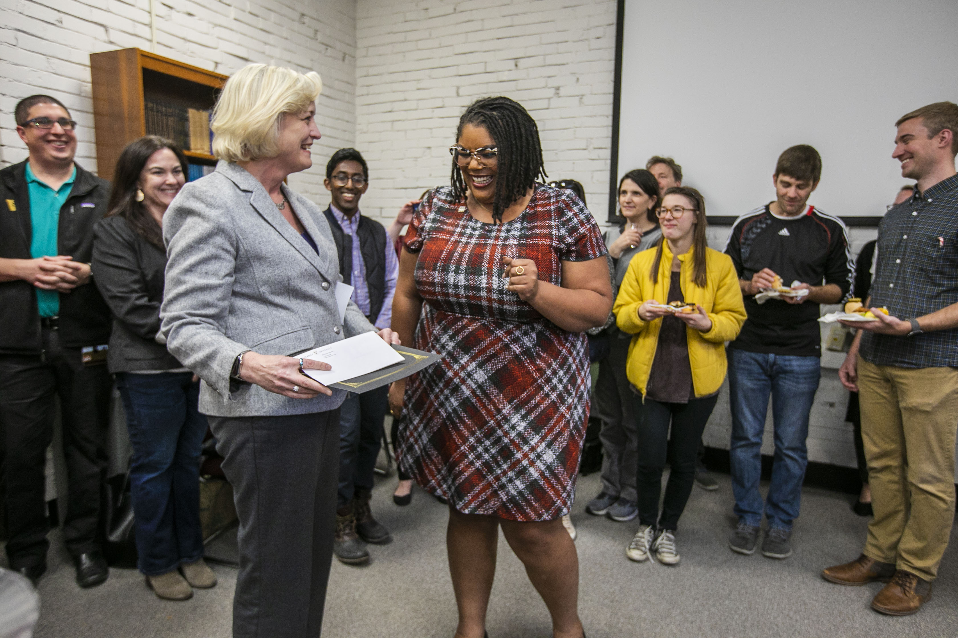 Interim Chancellor and Provost Susan R. Wente presents the Heart and Soul Staff Appreciation Award to Educational Coordinator Ally Armstead. (Anne Rayner/Vanderbilt)