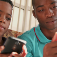 African American boys on cell phones