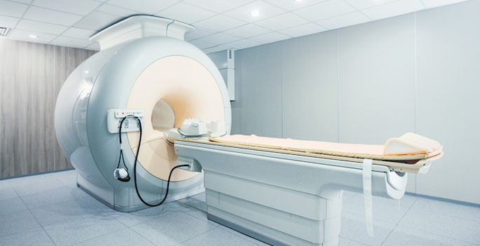 Closeup of a state of the art MRI scanner at a hospital with retractable bed.