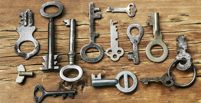 Old fashioned keys on wooden background