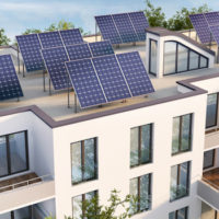 Modern apartment building with solar panels on the roof