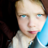 Little boy dressing up as a fictional Jedi character. Focus on eyes.