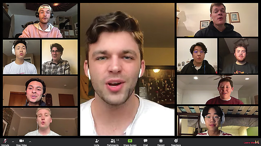 a computer screen shot of students in remote locations singing together over a video conferencing platform