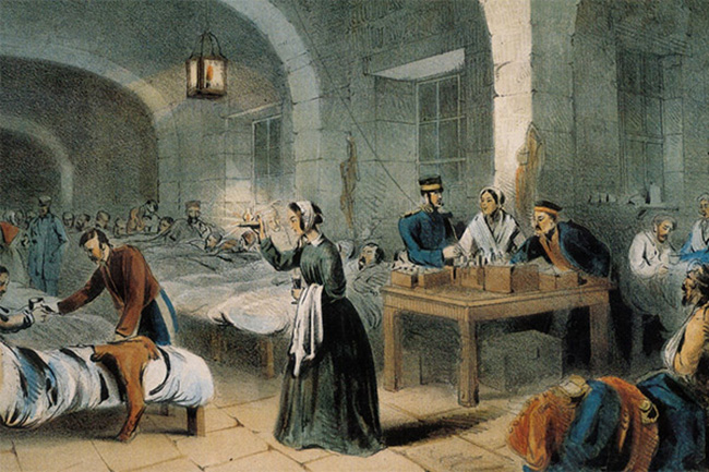 """'Florence Nightingale in the Military Hospital at Scutari', 1855 (c). It is at the National Army Museum in London, and is a colored lithograph by and after Joseph Austin Benwell, published by Peter Jackson, The Caxton Press, London and Liverpool, 1856 (c). From the museum catalog: """"In the night scene, Florence Nightingale is shown on her inspection rounds of the cramped wards of the hospital at Scutari during the Crimean War (1854-1856). In what was to become an iconic image of her, Miss Nightingale is seen holding a lamp in her hand."""""""
