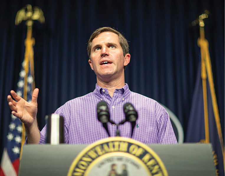 photo of Gov. Andy Beshear speaking at a podium