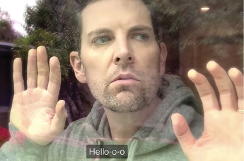 screen shot of Chris Mann singing 'Hello'