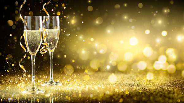 Two Champagne Glasses On Glitter (Getty Images)