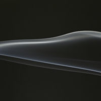 abstract concept of black smoke wave against black background