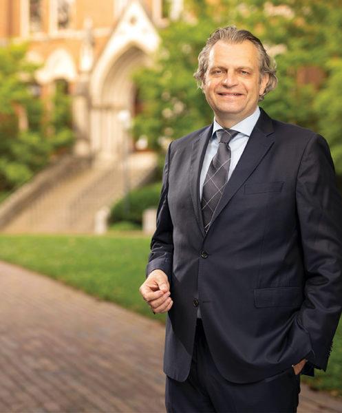 photo of Chancellor Daniel Diermeier in front of Kirkland Hall