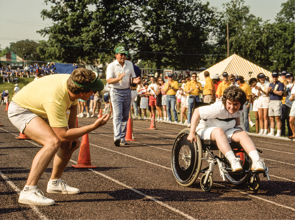 photo of Special Olympian competing in a wheelchair event