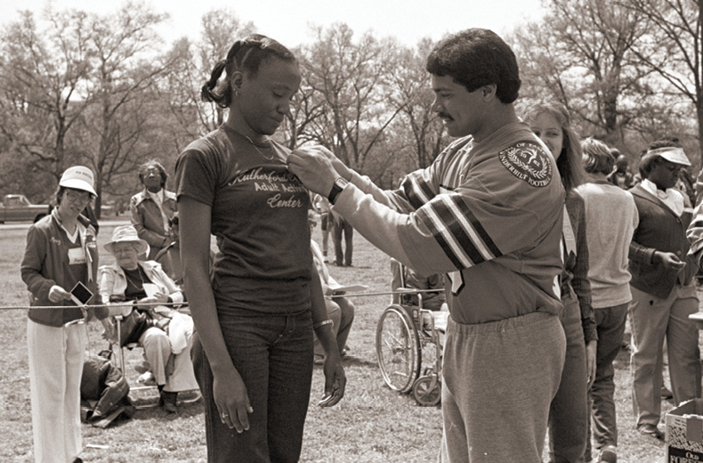 photo of a Special Olympian being awarded a medal