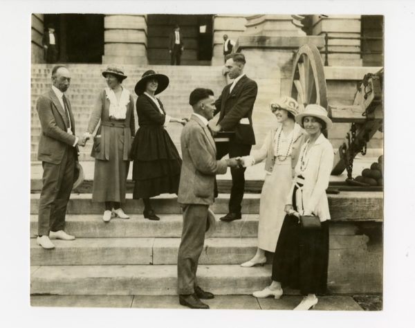 Photo taken outside the Tennessee State Capitol Building on Aug. 18, 1920. L-r: Rep. Banks Turner, BA 1910, shaking hands with Catherine Flanagan; Anita Pollitzer shaking hands with Rep. Harry Burn; Rep. Thomas Simpson (front) shaking hands with Betty Gram; Sue Shelton White in the very front. (Photo courtesy of The National Woman's Party at Belmont-Paul Women's Equality National Memorial.)