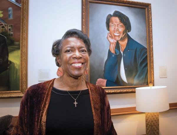 Dorothy Phillips poses beside her Trailblazer portrait