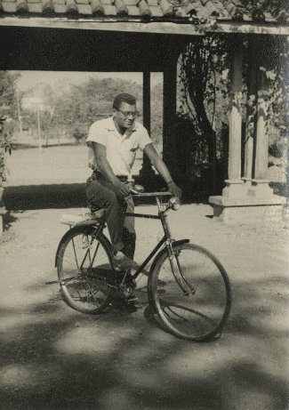 the Rev. James M. Lawson Jr. riding a bicycle in India during the 1950s