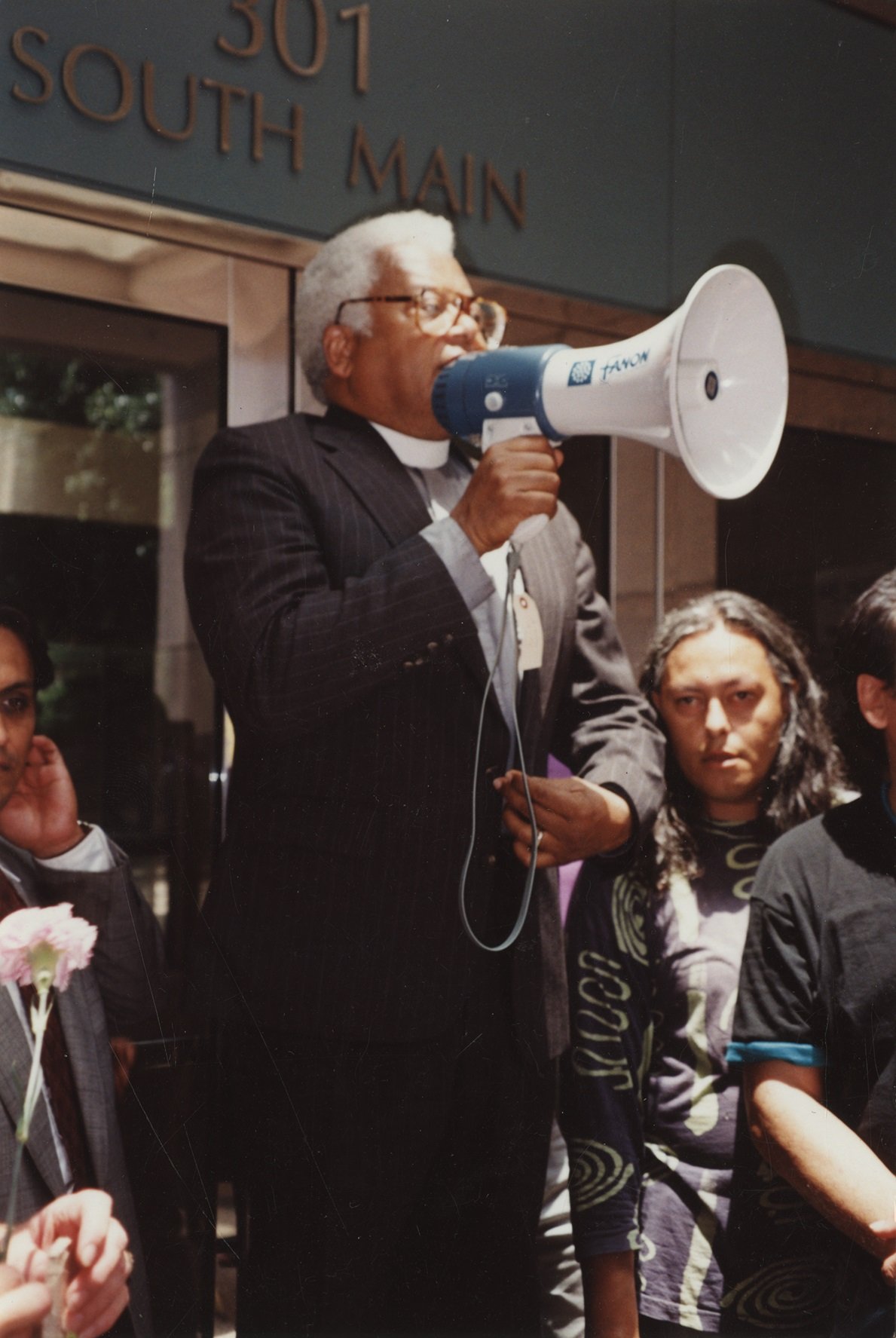 the Rev. James M. Lawson Jr. speaking to a crowd with a megaphone